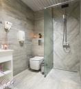 bathroom in astera hotel toilet shower